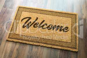 Welcome Mat On A Wood Floor Background