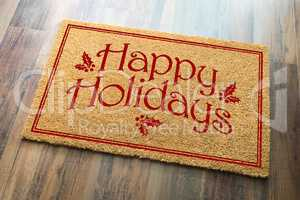 Happy Holidays Christmas Tad Welcome Mat On Wood Floor Backgroun
