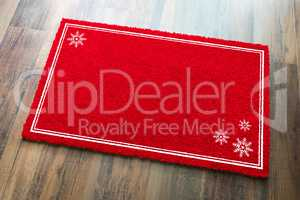 Blank Holiday Red Welcome Mat With Snow Flakes On Wood Floor Bac