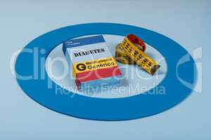 Blue circle with some Diabetes equipment do treatment the disease.
