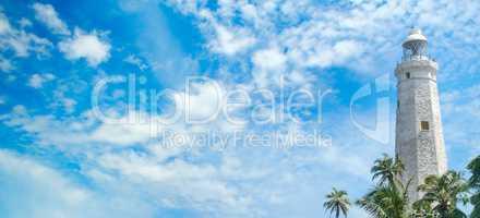 Lighthouse, lagoon and tropical palms (Matara Sri Lanka). Wide p
