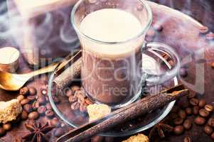 Hot coffee cup with coffee beans