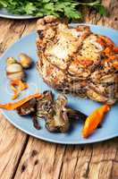 Delicious baked meat, stuffed with mushrooms