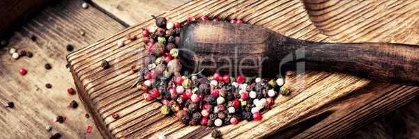peppercorn in rustic mortar
