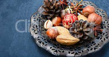 Christmas composition with nuts, spices and cone