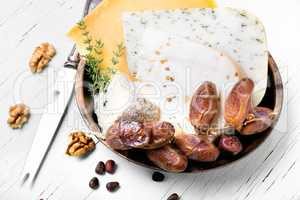Swiss cheese with pine nuts