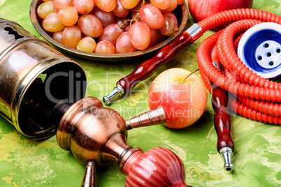 Stylish oriental shisha with grapes