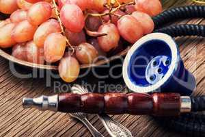 Stylish oriental shisha with grapes