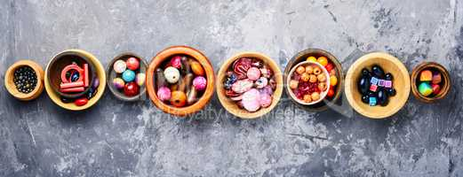 Colorful beads in wooden bowls