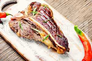 Sirloin steak on cutting board