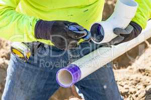 Plumber Applying Pipe Cleaner, Primer and Glue to PVC Pipe