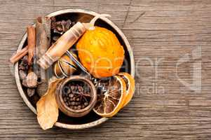 Ingredients for mulled wine on rustic background