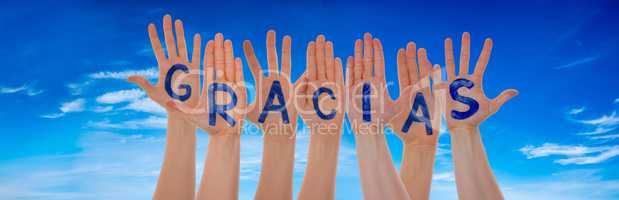Many Hands Building Gracias Means Thank You, Blue Sky