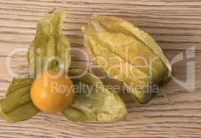 Physalis fruit (Physalis Peruviana) with husk on wooden backgrou