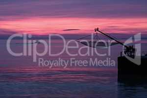 Wonderful magenta sunrise from the pier of Senigallia, Italy