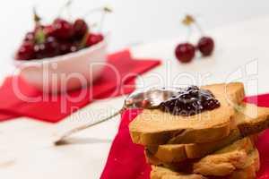 Closeup of rusk with cherry jam