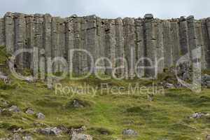 Wall of high basalt columns in Iceland.