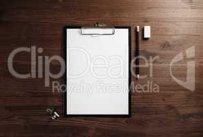 Clipboard, letterhead, pencil, eraser