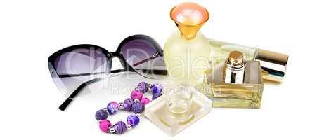 Perfume bottles, sunglasses and bracelet isolated on white backg