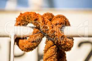 knot of a mooring line on a railing