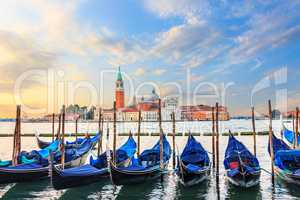 Gondolas moored at the pier in Grand Canal with San Giorgio Magg