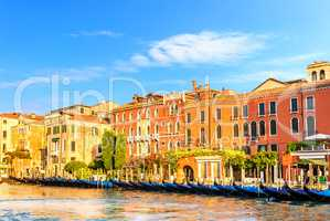 Venice palaces with gardens by the channel and gondolas in front