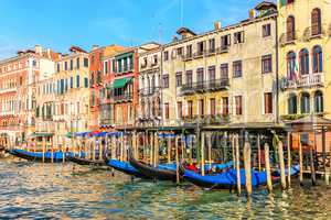 Street cafe in Venice on the pier of gondolas in Grand Canal, It