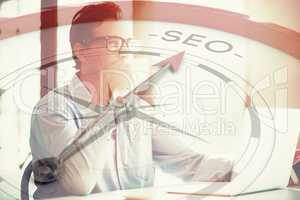 Composite image of compass pointing to seo