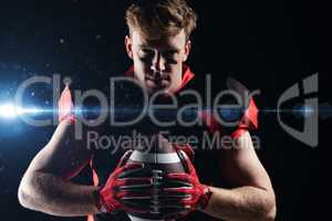 American football player holding rugby