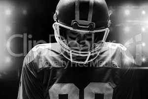 American football player standing with rugby helmat