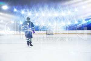 Composite image of rear view of player holding ice hockey stick
