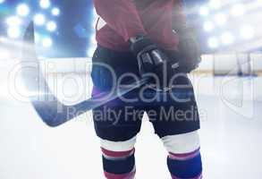 Composite image of mid section of hockey player holding stick