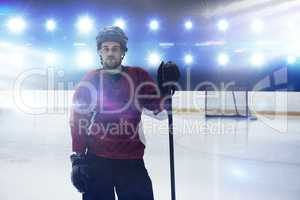 Composite image of portrait of ice hockey player at rink