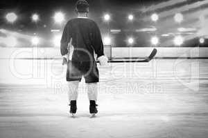 Composite image of ice hockey player on the ice
