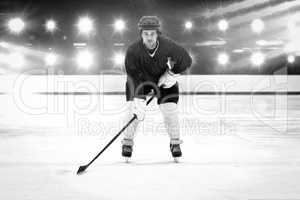 Composite image of player playing ice hockey
