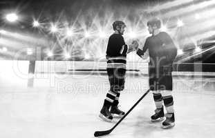 Composite image of ice hockey players shaking hands at rink