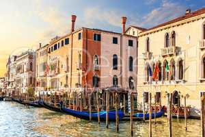 Venice palaces and gondolas in summer sun in the Grand Canal