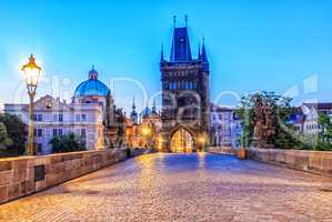Charles bridge and Old Town of Prague in morning twilight
