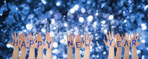 Hands Building Word Happy New Year, Glittering And Sparkling Bokeh Background