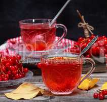 Fresh hot tea from viburnum berries in a transparent glass cup