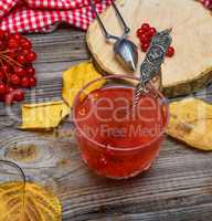tea from viburnum berries in a transparent glass cup