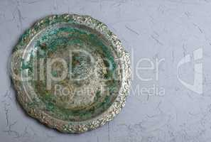 empty round metal plate on gray background, empty space