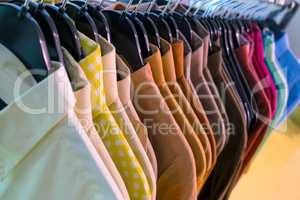 Male Mens Shirts on Hangers in a Shop