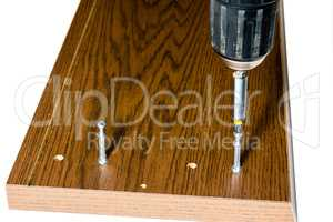 Screwing the screed onto the drawer lid