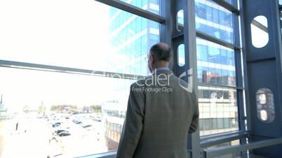 Senior businessman looking at window