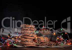 round chocolate cookies in a stack, around the New Year's burnin