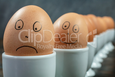Happy Sad Emotional Concept Eggs in Egg Cups