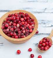 berries of ripe red cranberries in a wooden plate