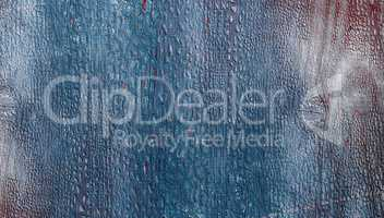 blue wooden background with cracked