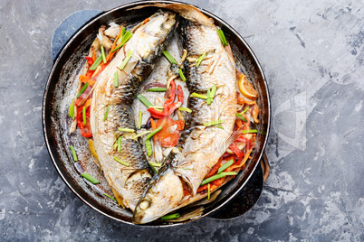 Baked fish in a pan